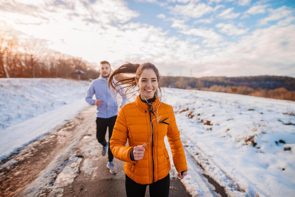 man and a woman jogging