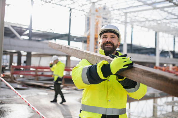 how to lose water weight: hard hat worker smiling while working