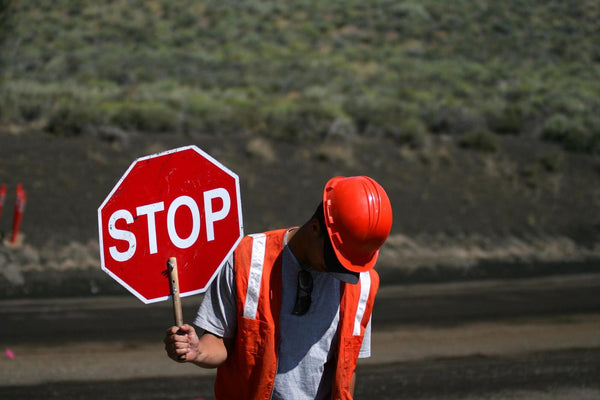 man holding a stop sign