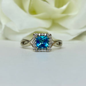 Passion Topaz & Diamond Halo Ring
