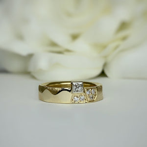 Custom designed faceted band with princess cut diamond