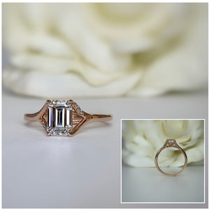 Emerald cut moissanite engagement ring