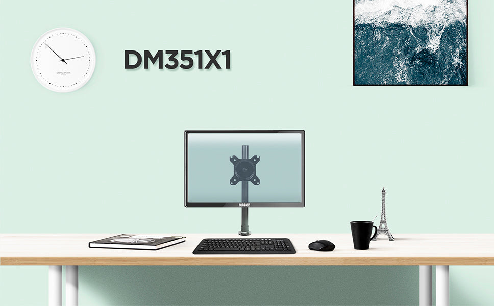 DM351X1 monitor stand on desk top surface, surrounded by office accessories.