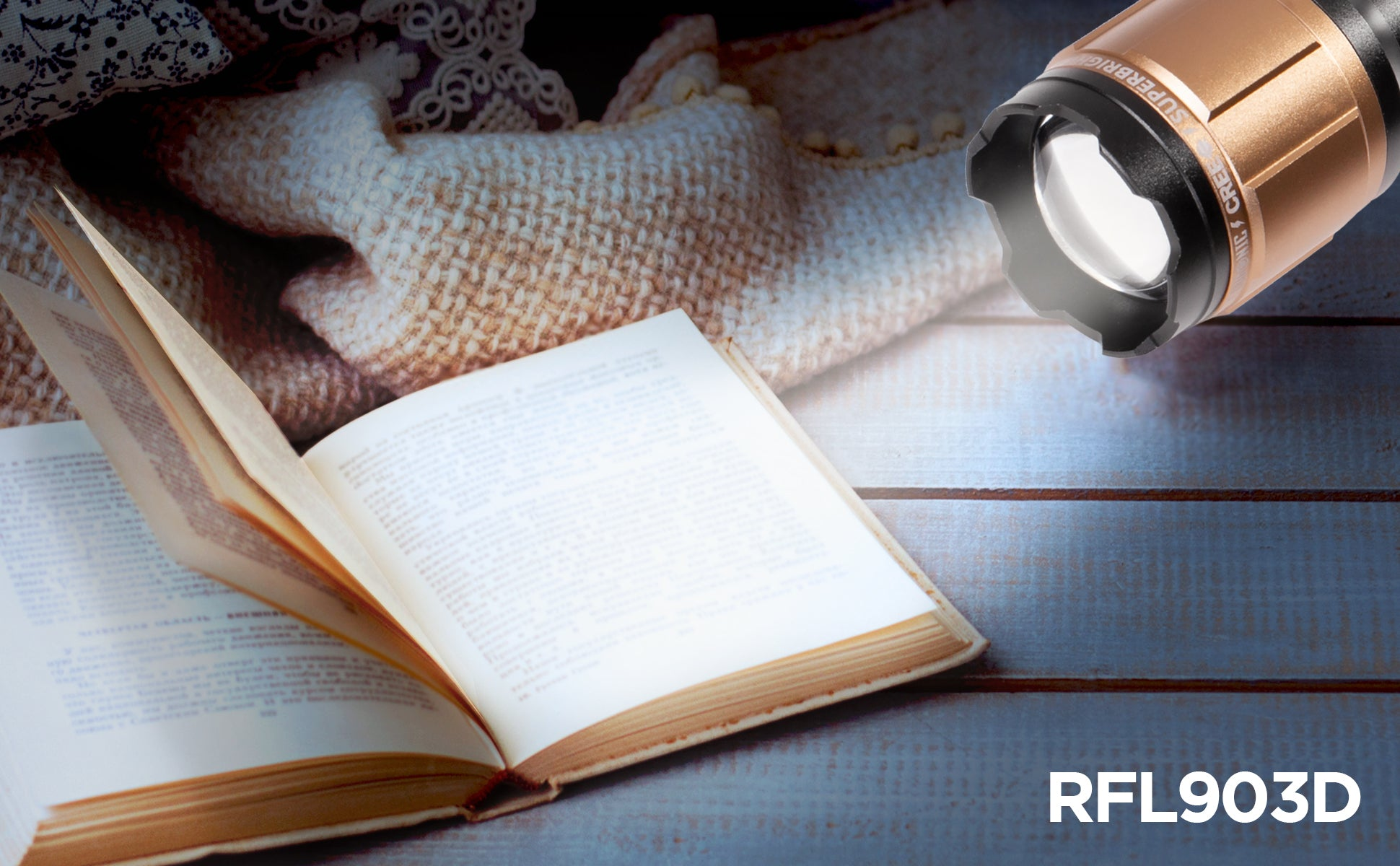 RFL903D torch shining onto an open book on top of a cosy blanket