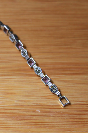 STERLING SILVER BRACELET WITH ALTERNATING MARCASITE & SYNTHETIC AMETHYST LINKS - 7.5""