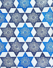 Load image into Gallery viewer, A printed floral star pattern in shades of blue