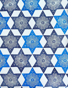 A printed floral star pattern in shades of blue