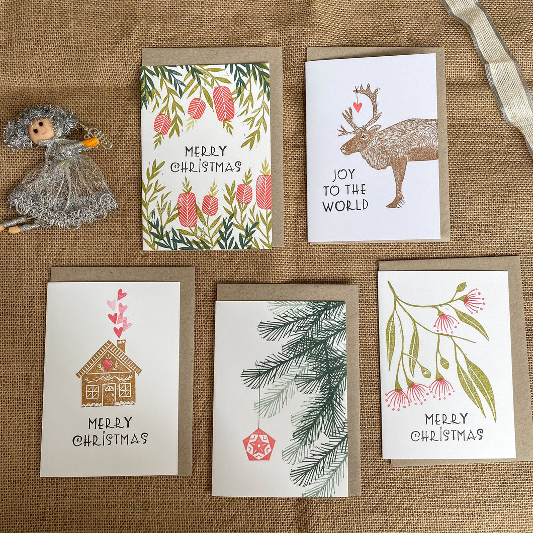 A set of 5 hand printed Christmas cards with a mix of designs