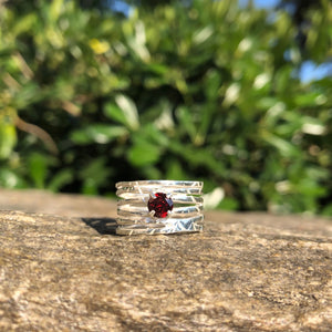 Silver wave ring with red garnet