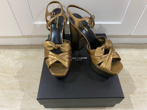 Karla Estrada's Saint Laurent Metallic Candy 80 Bow platform Sandal