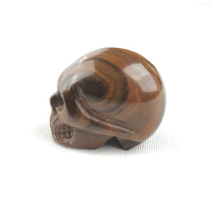 BUTTON DOWN CARVED STONE SMALL SKULL - RED TIGER EYE