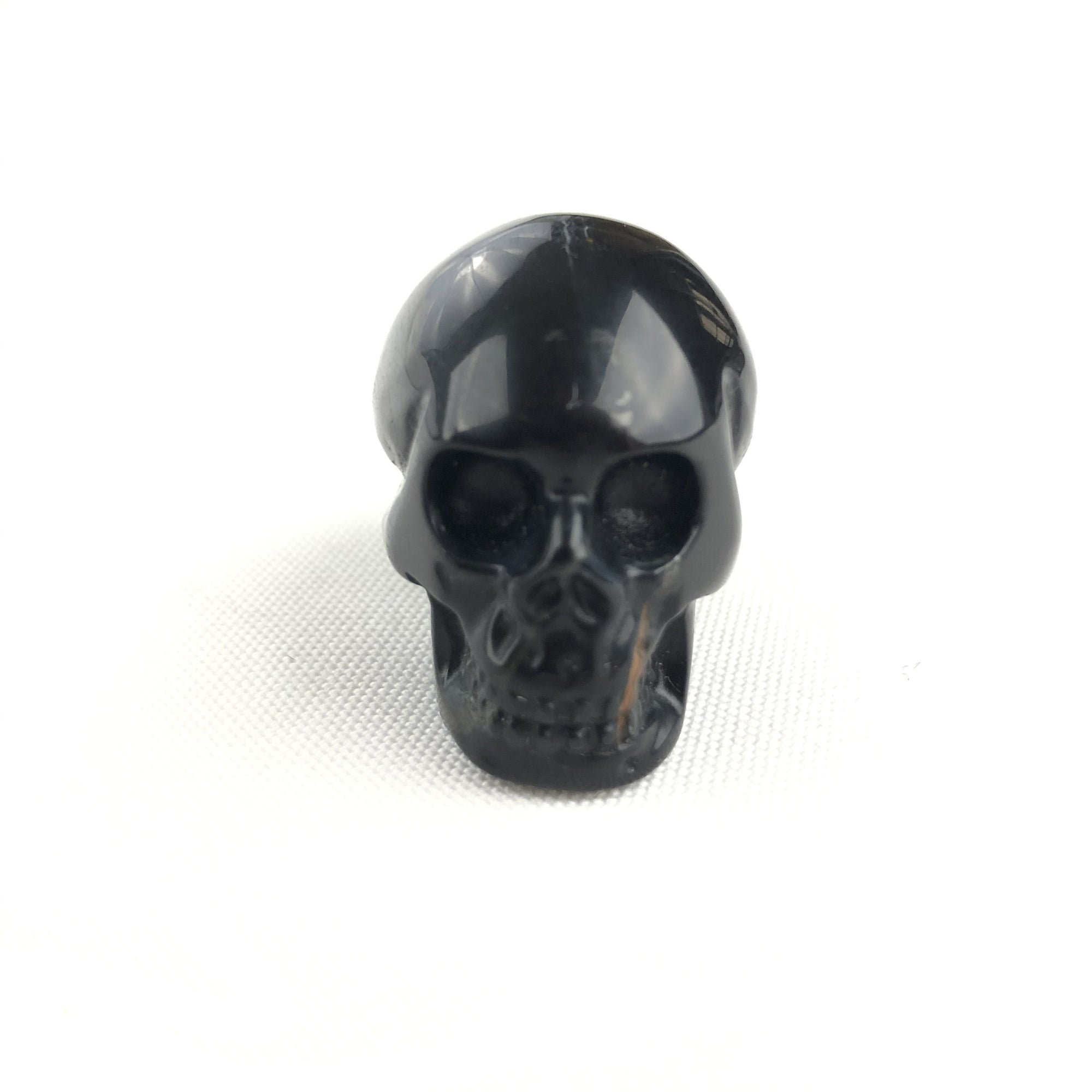 BUTTON DOWN CARVED STONE SMALL SKULL - BLUE TIGER EYE