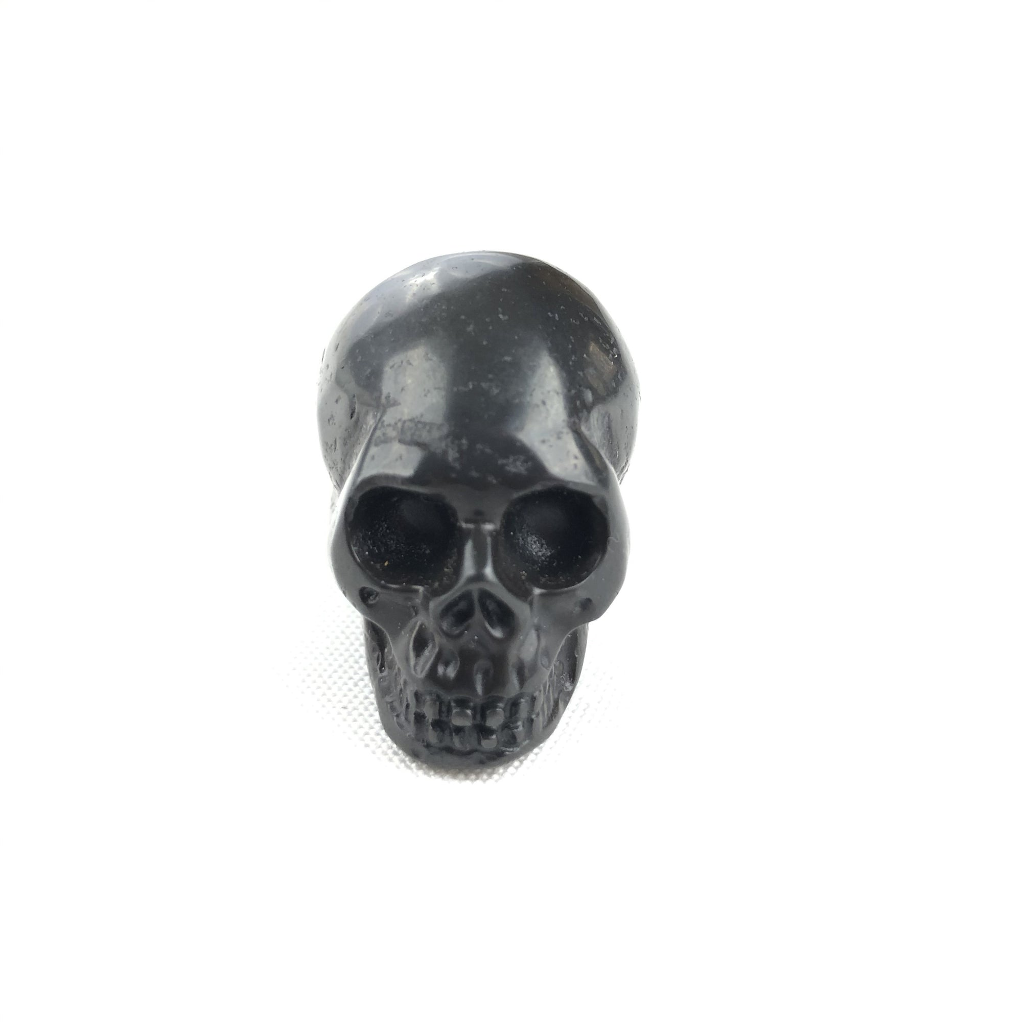 BUTTON DOWN CARVED STONE SMALL SKULL - HEMATITE