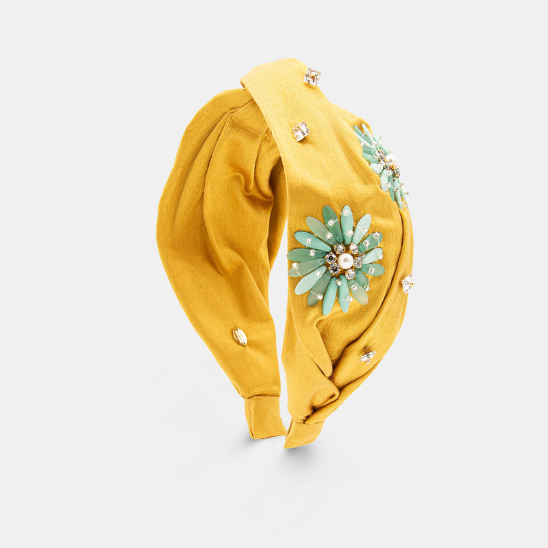 Twisted knot headband with flower embroidered  designed by Maryjane Claverol.