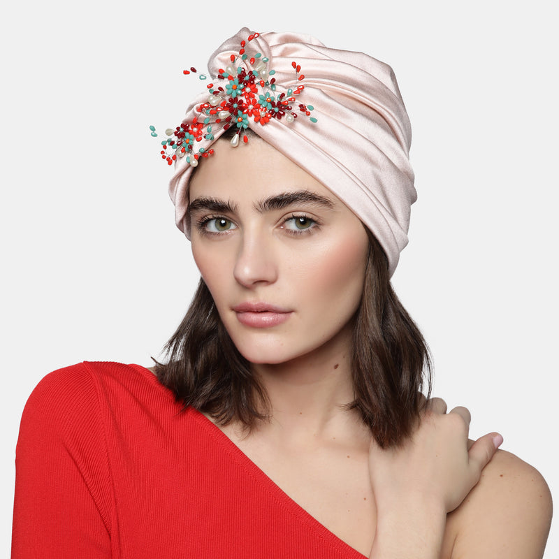 Front knot turban designed by Maryjane Claverol.