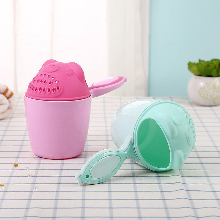 wash cup for washing toddlers or babies hair.  green/pink