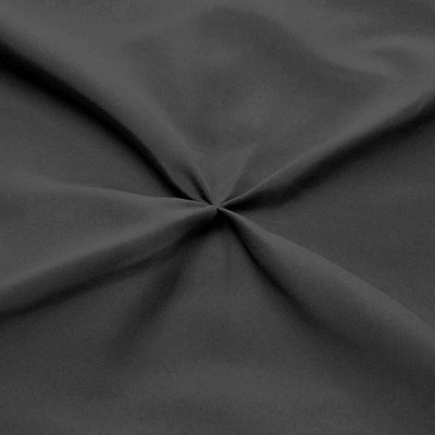 Luxurious dark grey pinch pleated bed skirt