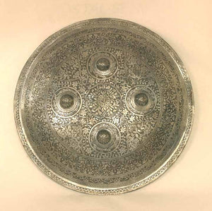 Round shield with floral design