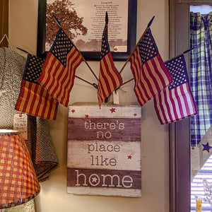 This primitive flag holder can easily be mounted indoors or outdoors. The set includes a sturdy iron mount and five tea-stained fifty star flags.