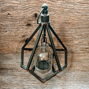 Geometric Metal Votive Lanterns are a fantastic accent for any style. These vintage looking lanterns hold one votive candle