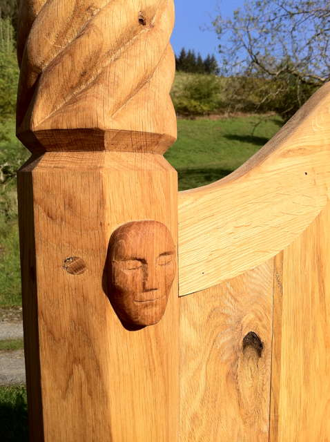 carved head on storytelling chair
