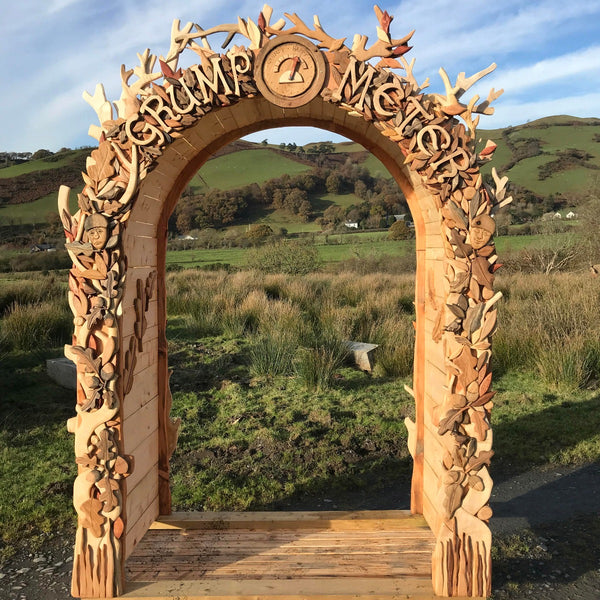 hand-carved wooden arch
