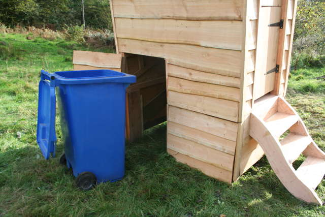 wheelie bin in compost toilet