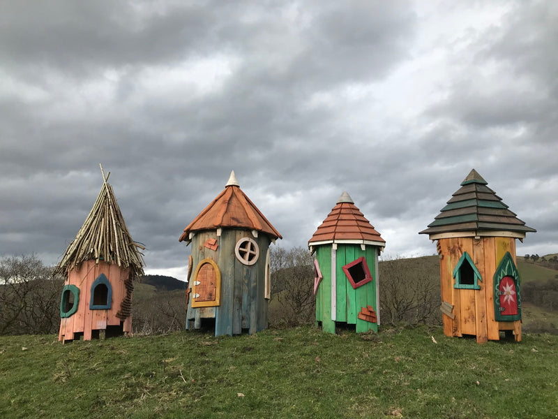 fairy houses in field
