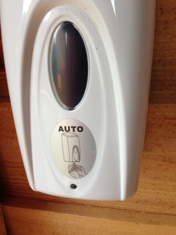 alcohol dispenser for compost toilet