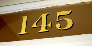Traditional address numbers in Gold for transom windows by House Number Lab - Baltimore Style, 22K Gold Leaf, Customizable at housenumberlab.com