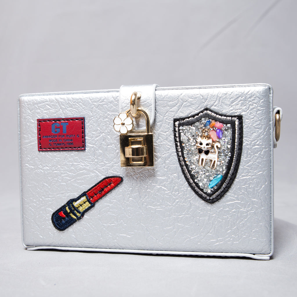 Silver clutch with patchwork details