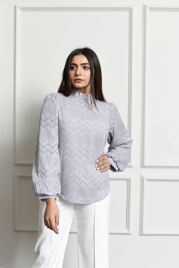 Blouse with metallic accents