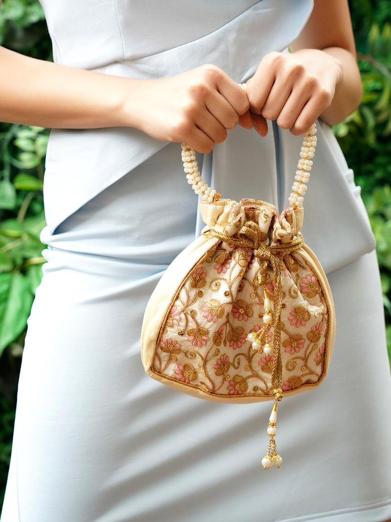 Off-White Potli Bag embroidered in golden and pink!