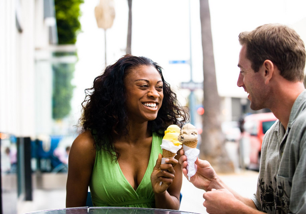 Couple Eating Ice Cream With Waffle Cones
