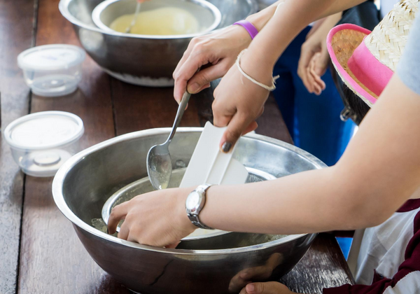 Family Making Ice Cream At Home