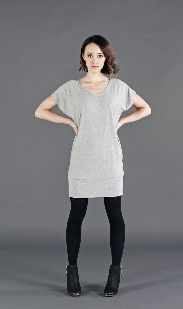 Casual yet trendy; a relaxed fit short sleeve top with a bottom bandeau.