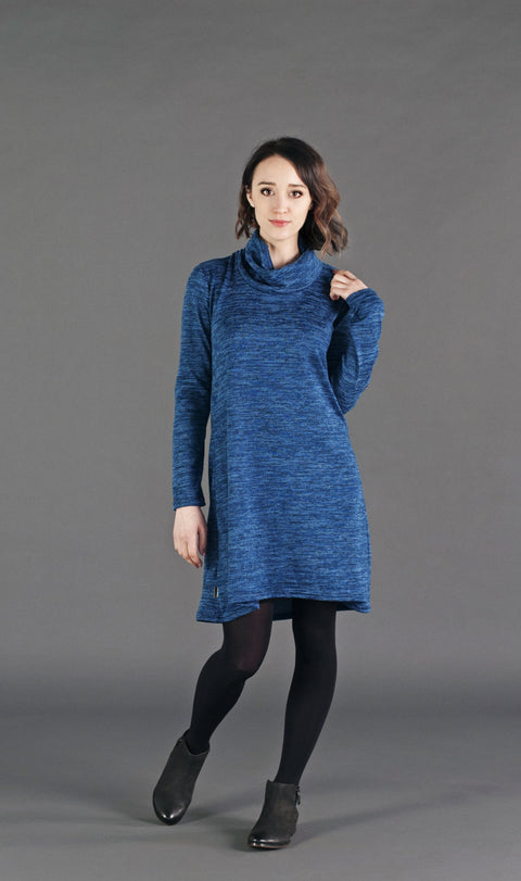 A relaxed fit ombré knit dress with a cowl neck and full sleeves.