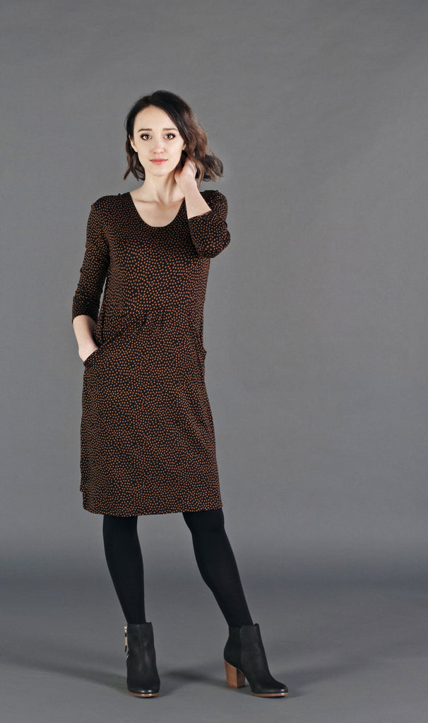 Relaxed fit jersey dress with defined waistline and side pockets. Has 3/4 sleeves and a  raised hem in the front for a modest high/low effect.