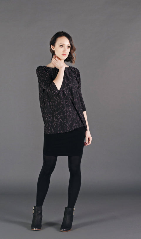 Casual yet trendy; a relaxed fit top with fitted sleeves.