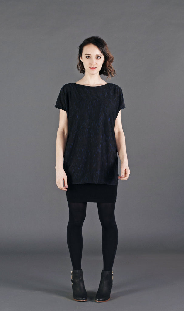 Relaxed tunic top with capped sleeves. Great for layering!