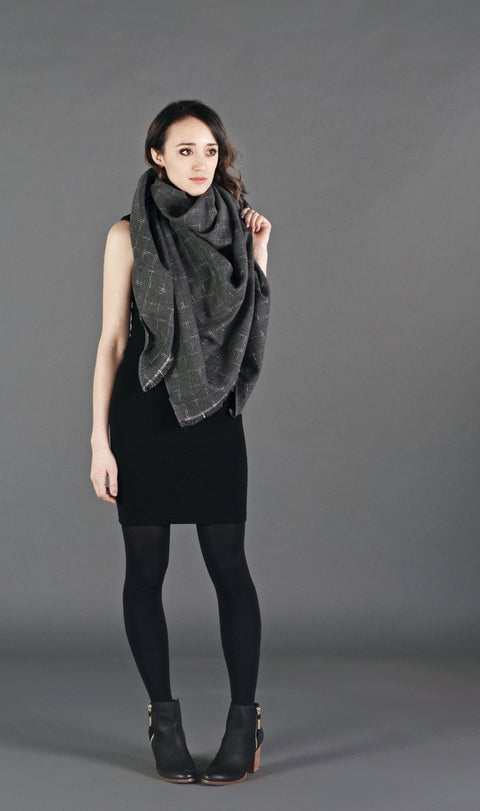A stylish one size dapper tweed blanket scarf that can be worn as a wrap around scarf or shawl.