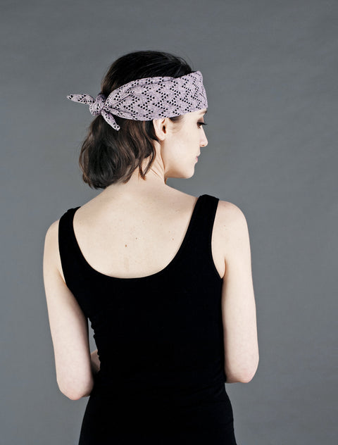 A lovely heart knit tie up headband adjustable for all sizes. Can be worn with tie to the front or