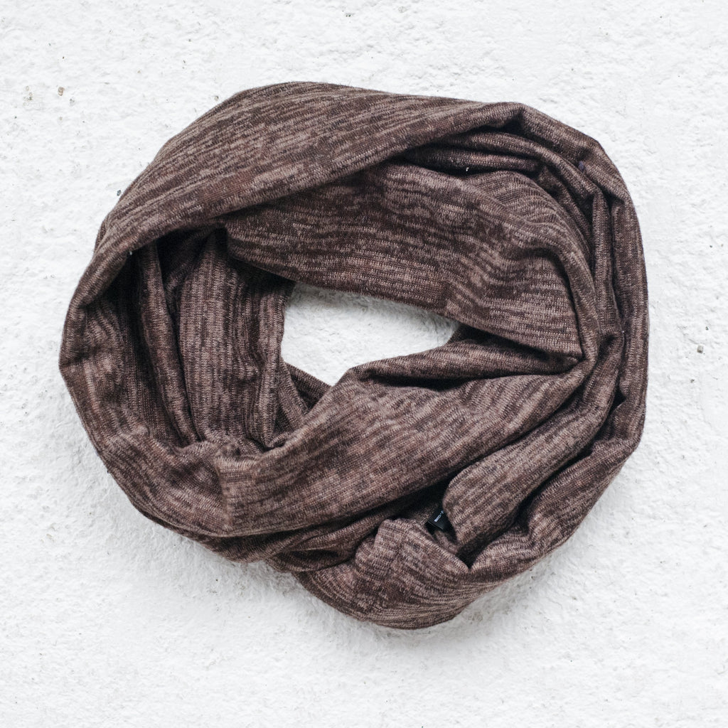 "Sweater knit infinity scarf. Sewn with a twist for added texture. Measures 56"" x 7""."