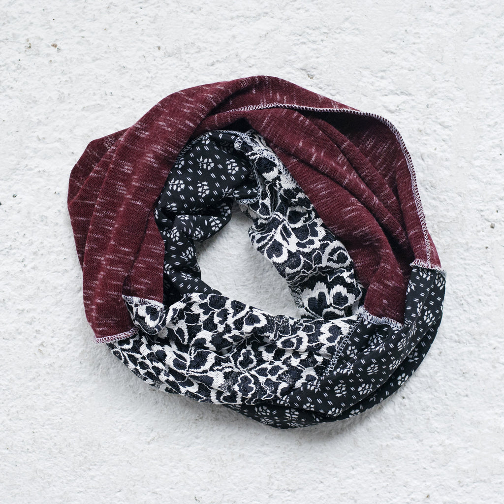 "A stylish multi-textured patch scarf. Measure 58"" x 8""."
