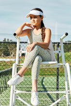 Load image into Gallery viewer, young girl tween wearing yellow activewear watching tennis