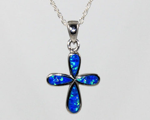 Cross pendant with blue lab created opal