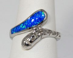 Sterling silver swirl ring with blue lab created opal