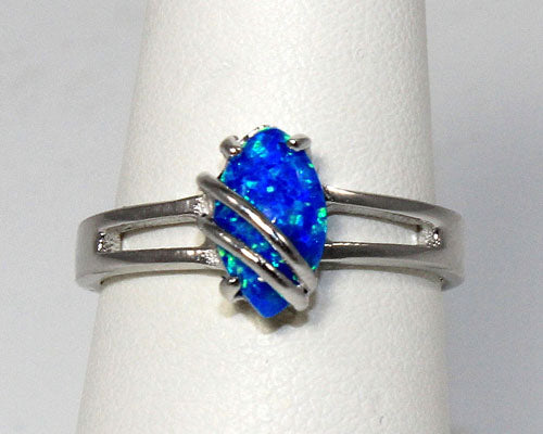 Sterling silver ring with a 6x9mm oval blue lab created opal
