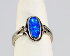 12 x 6mm Lab created opal in sterling silver ring