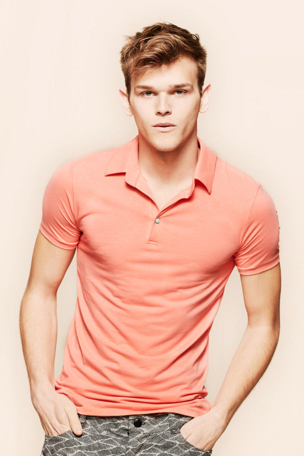 oda - men's coral polo - front view